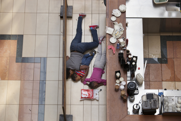 A woman and children hide inside Westgate Mall in Nairobi, Kenya, Sept. 21, 2013.