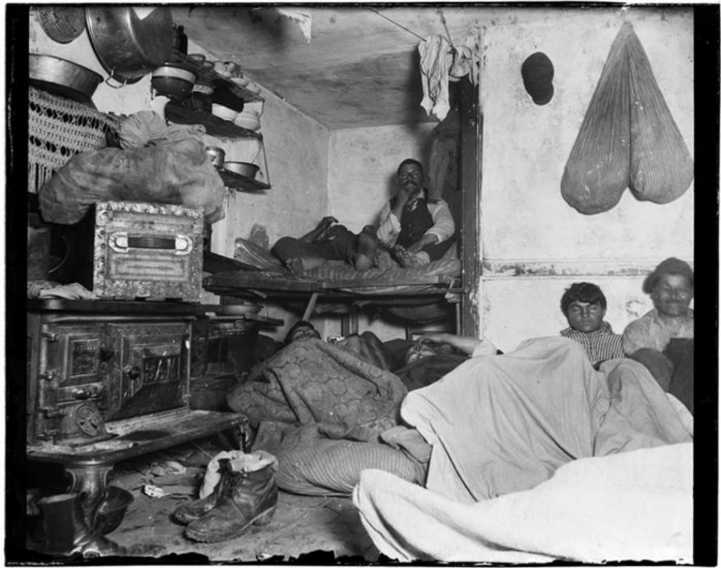 Lodgers in a crowded Bayard Street tenement, 1889. (Jacob A. Riis, Museum of the City of New York)