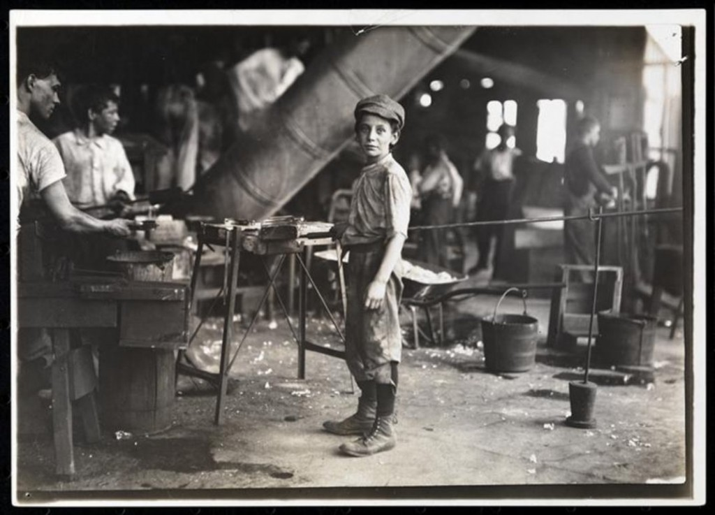 A boy in a glass factory, ca.1890. (Jacob A. Riis, Museum of the City of New York)