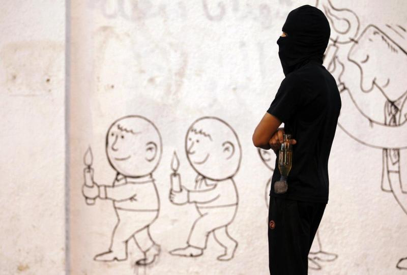 2014-10-18T202500Z_902145169_GM1EAAJ0B0X01_RTRMADP_3_BAHRAIN-PROTEST