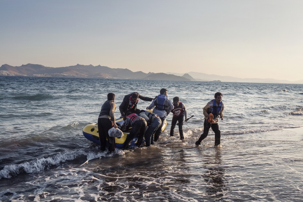 Sevenpeople from Pakistan arrive on the Greek island of Kos after rowing all night.