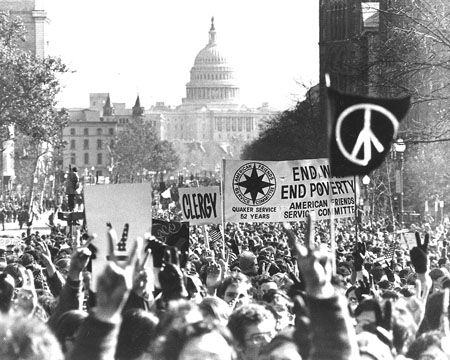 With the U.S. Capitol in the background, demonstrators march along Pennsylvania Avenue in an anti-Vietnam War protest in Washington, on Moratorium Day, November 15, 1969. (AP Photo)