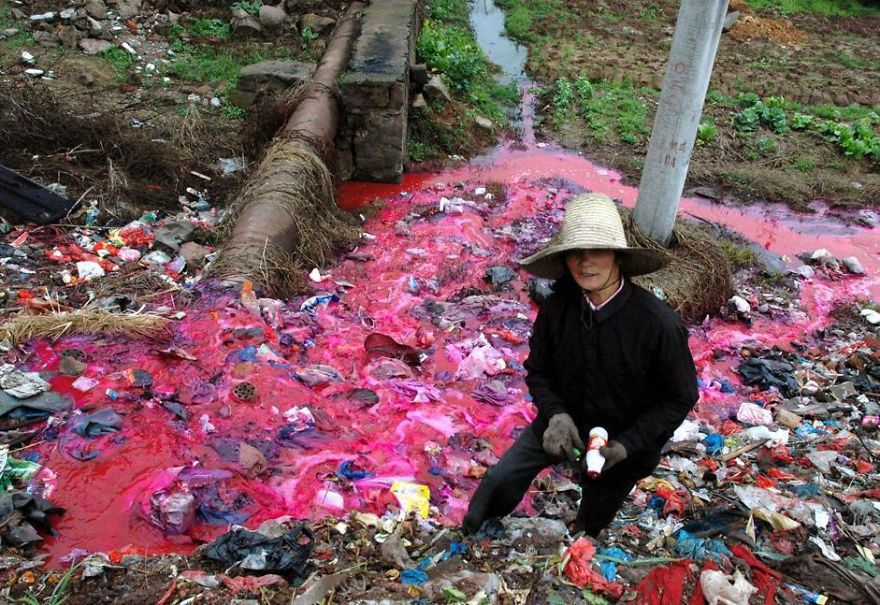 A woman collects plastic bottles near a river where water is polluted with a reddish dye in Dongxiang, in east China's Jiangxi Province Friday March 25, 2005. The river is polluted by waste water directly discharged from a small paper factory nearby. China's already severe water shortages are worsening due to heavy pollution of lakes and aquifers and urban development projects with a big thirst for water. A survey in January found that only 47 percent of water in China's major rivers is drinkable, while half of all lakes are heavily polluted. (AP Photo) ** CHINA OUT, ONLINE OUT ** - salom