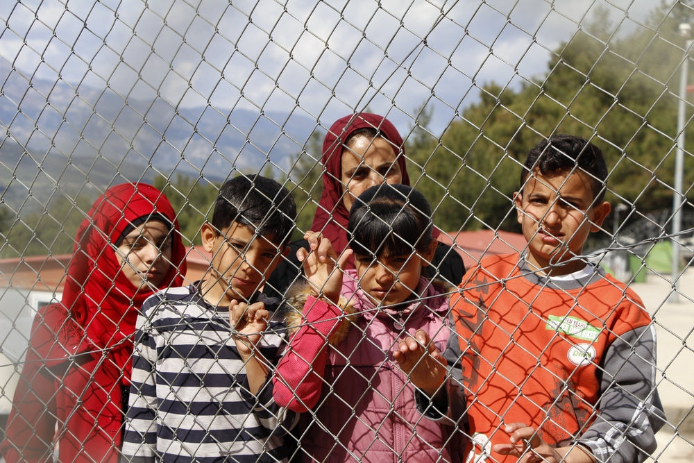 "Khadija, 42, is a mother of four from Syria who is now detained on Samos island, Greece, along with her children. She spoke to MSF from behind two metal fences. ""What is going to happen next? Will they kill us here in Europe? My husband was killed and our house was destroyed by a barrel bomb in 2013. Since then we have been moving from village to village looking for safety, until I lost hope and I brought my children to Turkey. I worked many jobs but it was so hard for me to manage with four children so I decided to come here to be safe. Yet here we are behind barbed wire like criminals, this is extremely unjust. For more details see: https://lc.cx/4BCC"