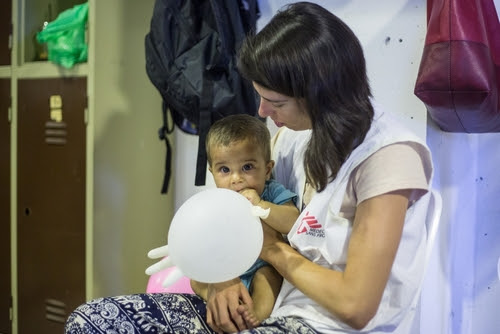MSF staff taking care of a child after he has been vaccinated.