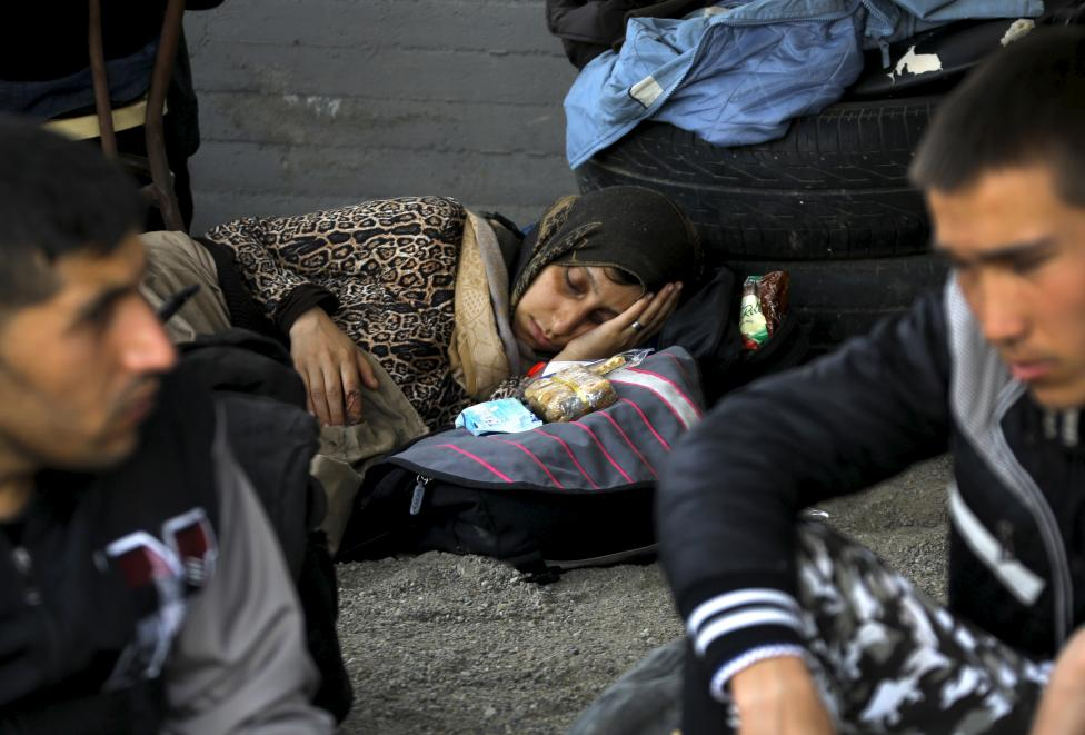 Syrian immigrants rest at the courtyard of a Greek police station in Idomeni village near the Greek-Macedonian border after they were rescued by locals May 13, 2015. About 90 Syrians including women and children were locked into a train wagon by smugglers, according to witnesses and a local train contractor at the train station. REUTERS/Yannis Behrakis