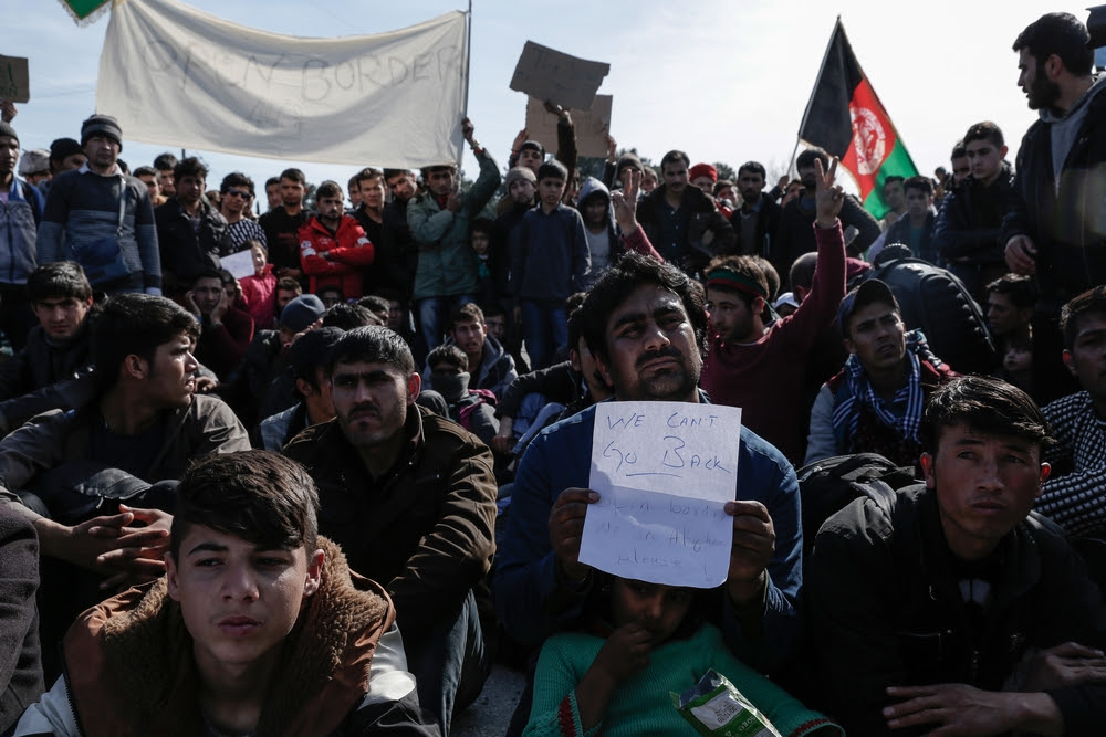 Afghans protest next to the Greek-Macedonian (FYROM) border near the northern Greek village of Idomeni. The FYROM authorities have closed the border to Afghan refugees.