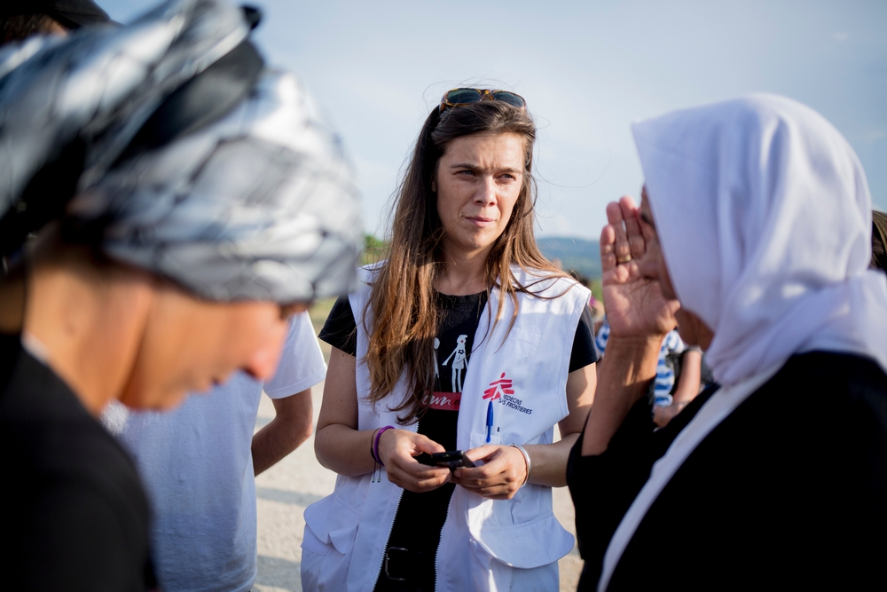 Melanie Kerloch, psychologist of the organization Doctor Without Border, talking with Refugees as the members of the Yazidi community leave the camp to protest against alleged threats.